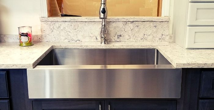 can I put a farmhouse sink in existing cabinets