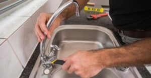 how to replace kitchen sink faucets